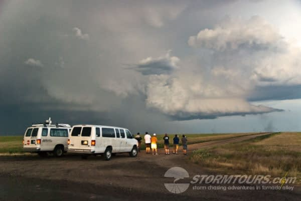 storm chase tours group with vans watching storm