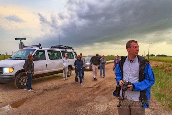 storm chase tours customer with camera